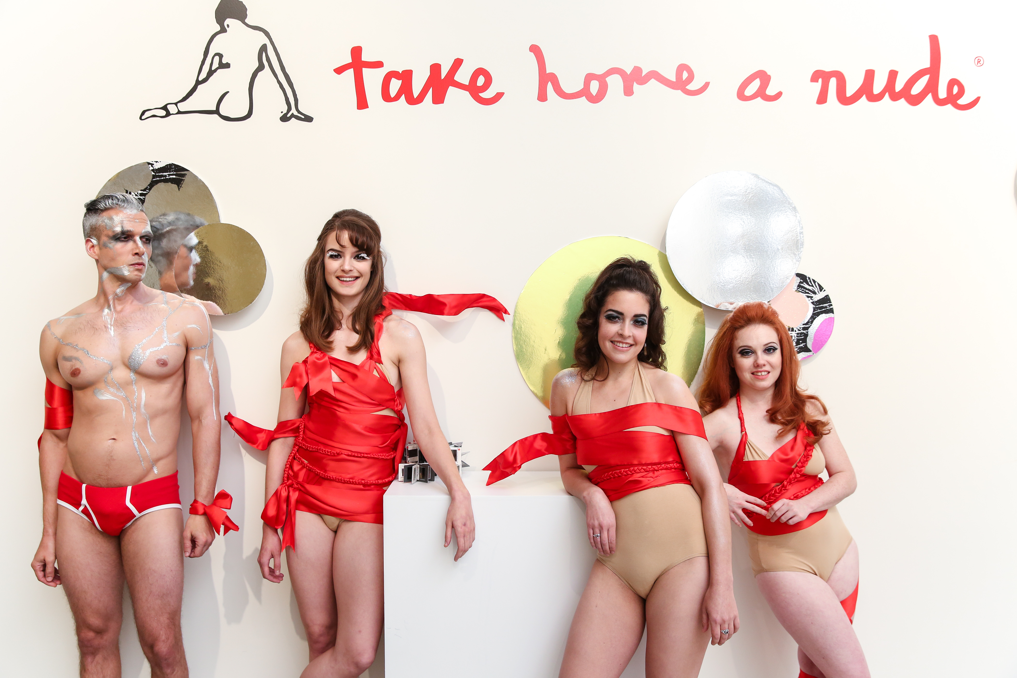 Scantily clad people at Take Home a Nude.
