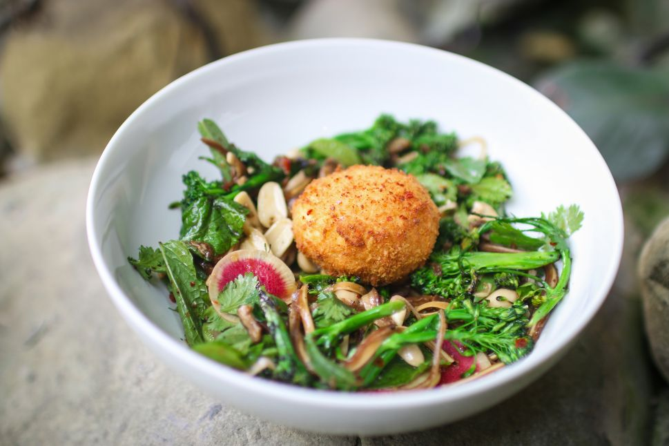 Miles Thompson serves blistered baby broccoli with pig ears and an egg on top at Michael's Santa Monica.