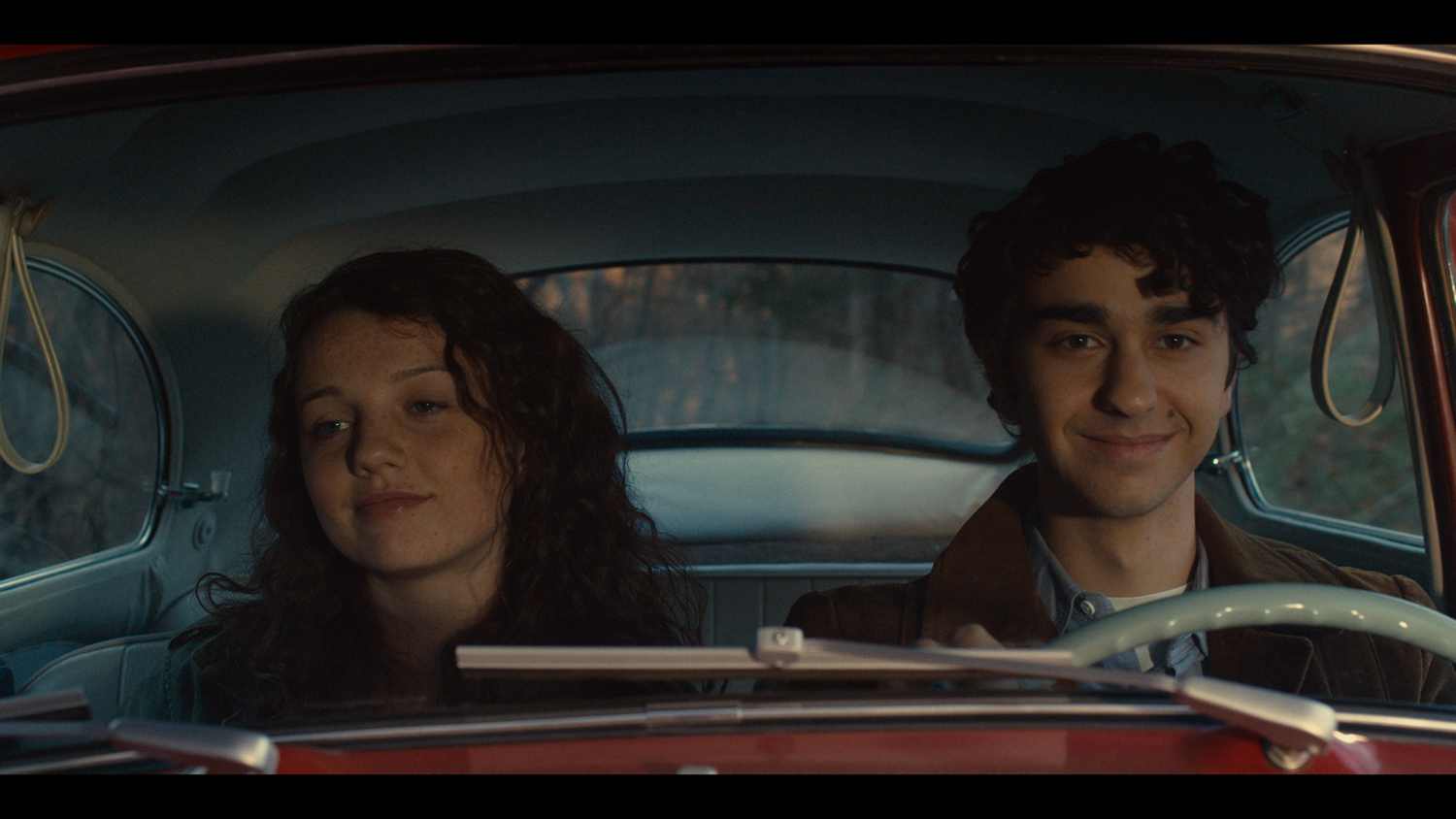 Alex Wolff and Stefania Owen.