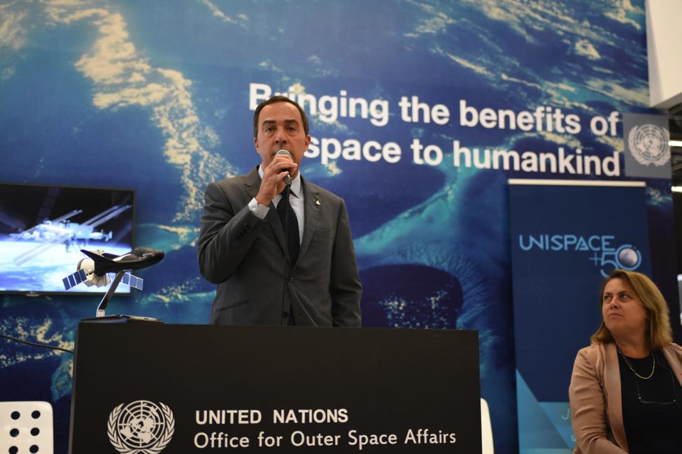 SNC Vice President Mark Sirangelo and UNOOSA Director Simonetta Di Pippo announce the new space program at the IAC.