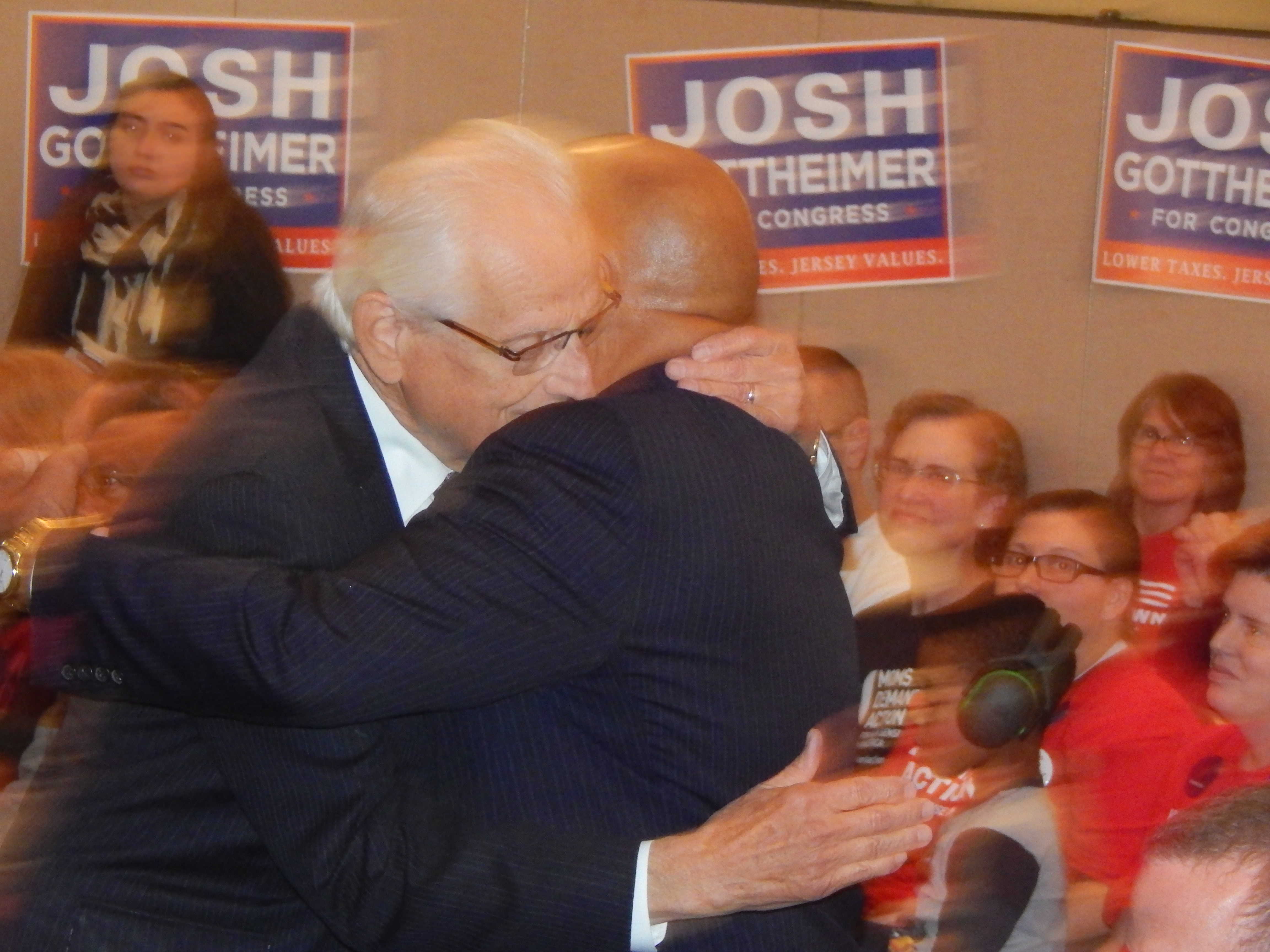 Pascrell and Lewis embrace after the Paterson congressman's remarks.