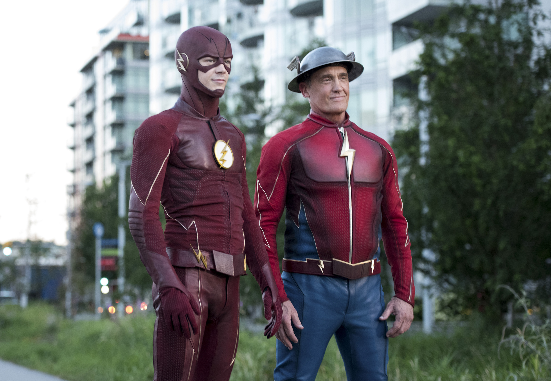 Grant Gustin as The Flash and John Wesley Shipp as Jay Garrick.