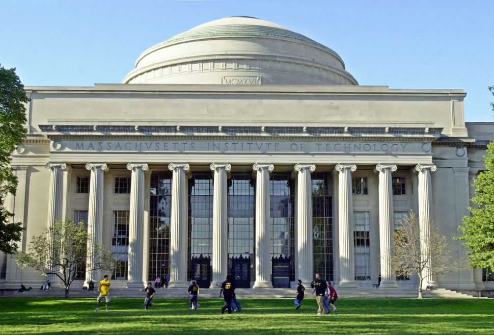 Massachusetts Institute of Technology students play football outside the Maclaurin building. The school took the second place spot in the WSJ's recent ranking of US colleges.