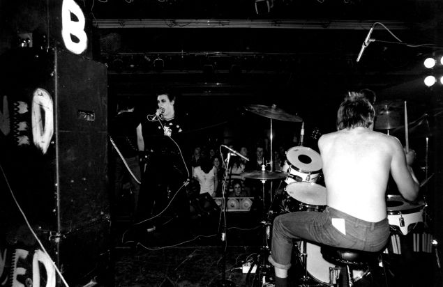 December 6, 1976: The Damned, from left to right Brian James (bass), Dave Vanian (vocals) and Rat Scabies (drums), performing at Leeds Polytechnic, the first date of the 'Anarchy Tour' with the Sex Pistols and Johnny Thunders and the Heartbreakers.