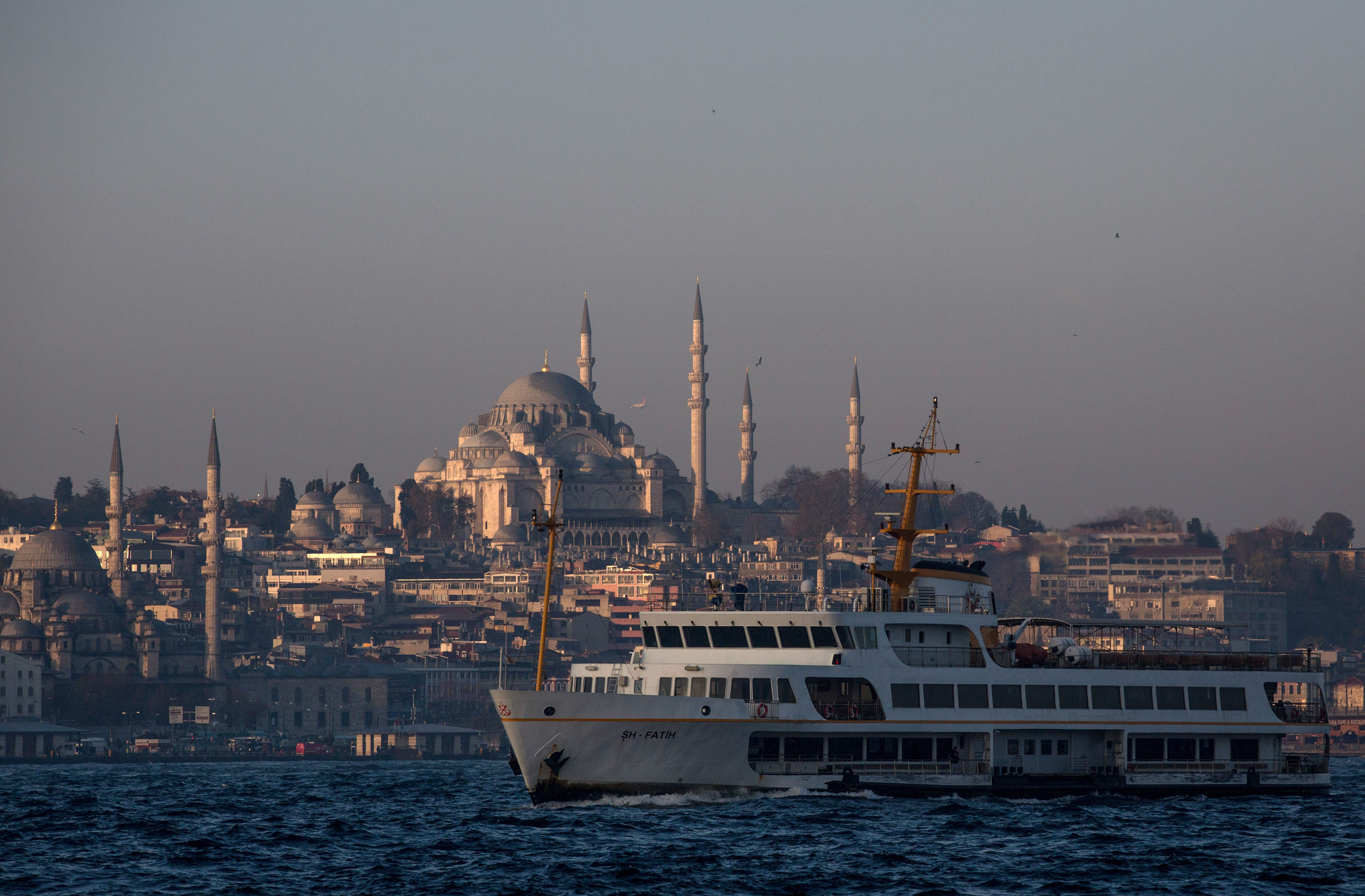 ISTANBUL, TURKEY - DECEMBER 14: A ferry is seen on route to the Asian side on December 14, 2015 in Istanbul, Turkey. Istanbul in Turkey's northwest is the only city on earth spanning two continents. The Bosphorus, a small stretch of water divides Europe from Asia. Istanbul's world famous ferries are one of the most popular ways to get around the city, it is estimated that more than 300,000 people take the ferry to work each day.