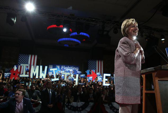 Hillary Clinton in her $12,495 Giorgio Armani jacket.