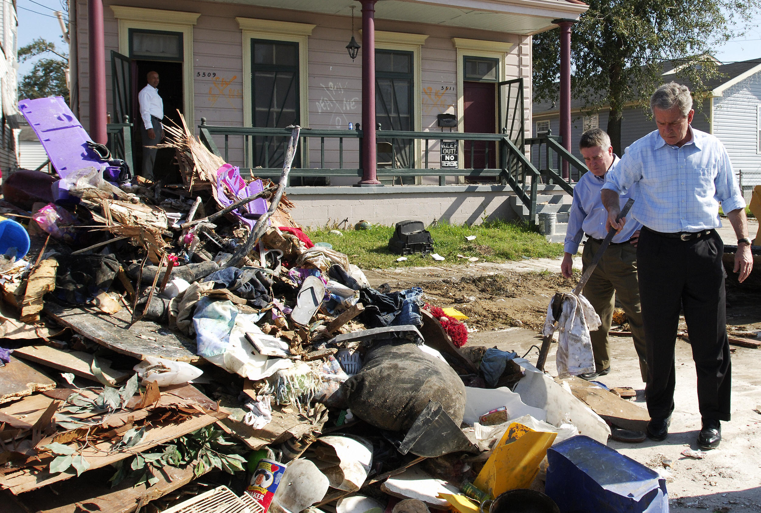 March 2006: Former US President George W. Bush picks up debris in the aftermath of Hurricane Katrina