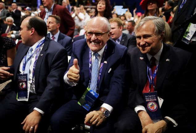 Former Mayor Rudolph Giuliani gives a thumbs up as New York GOP Chairman Ed Cox, looks on at the Republican National Convention.
