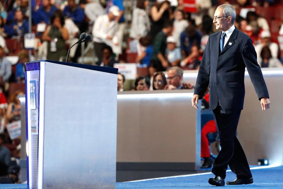 John Podesta, chair of the Hillary Clinton presidential campaign, walks on stage to deliver a speech on the first day of the Democratic National Convention at the Wells Fargo Center, July 25, 2016 in Philadelphia, Pennsylvania.