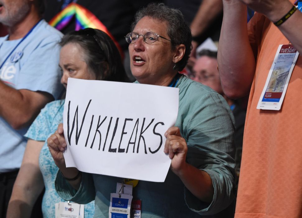 A woman holds up a sign referencing Wikileaks during Day 2 of the Democratic National Convention at the Wells Fargo Center in Philadelphia, Pennsylvania, July 26, 2016.