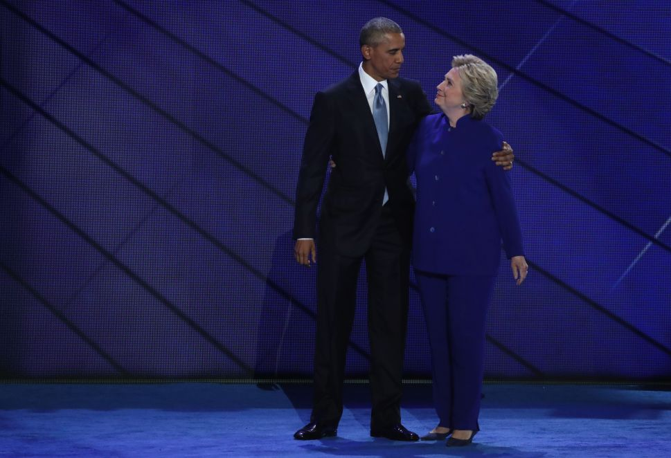 US President Barack Obama and Democratic Presidential nominee Hillary Clinton embrace on the third day of the Democratic National Convention at the Wells Fargo Center, July 27, 2016 in Philadelphia, Penn.