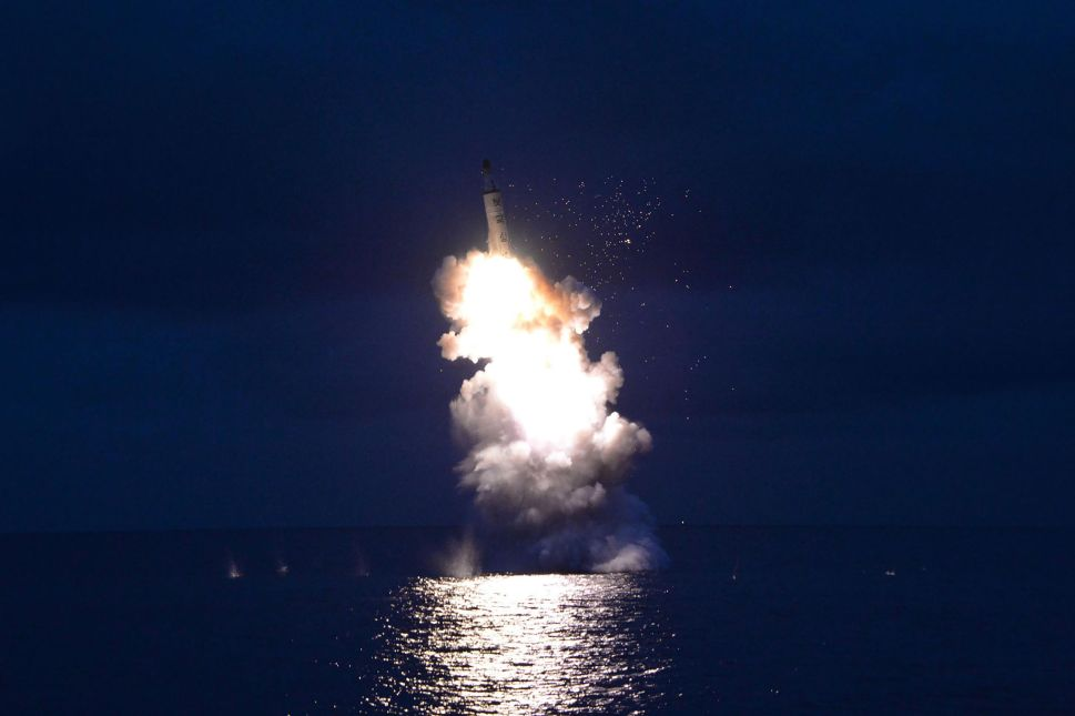 This undated picture released from North Korea's official news agency shows a test-fire of strategic submarine-launched ballistic missile being launched.