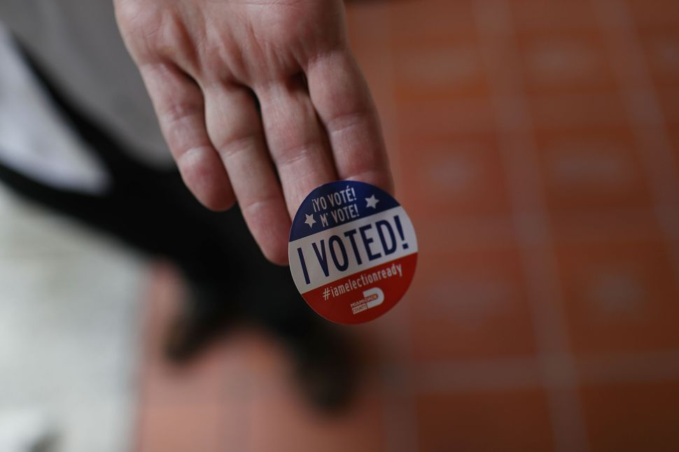 A voter shows off his, 'I Voted!', sticker after voting in the Florida primary on August 30, 2016 in Miami, Florida. There are Senate seats as well as congressional races that voters are weighing in on