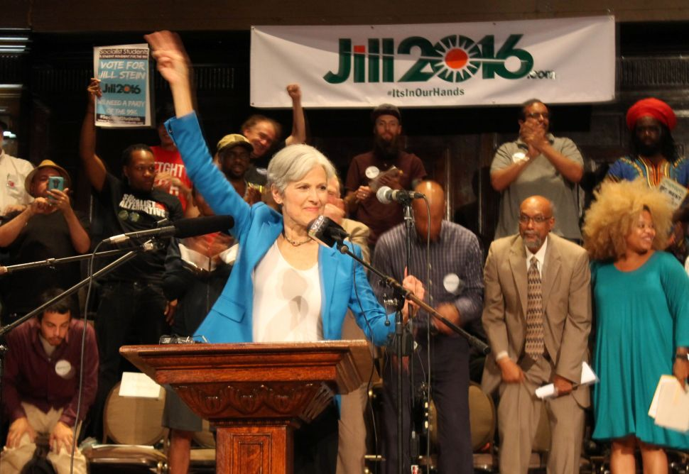 Green Party candidate Jill Stein waves a peace sign after discussing her active arrest warrant in North Dakota at a rally on September 8, 2016 in Chicago