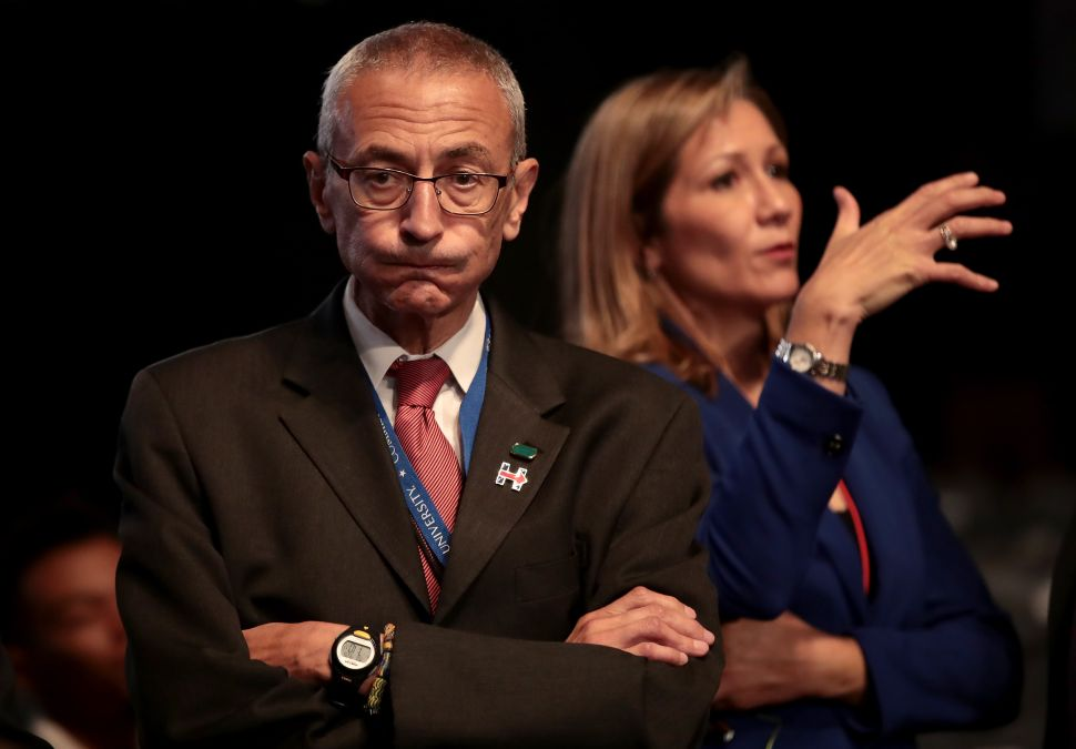 Democratic presidential nominee Hillary Clinton's Campaign Chairman John Podesta (L) looks on prior to the start of the Presidential Debate at Hofstra University on September 26, 2016 in Hempstead, New York.