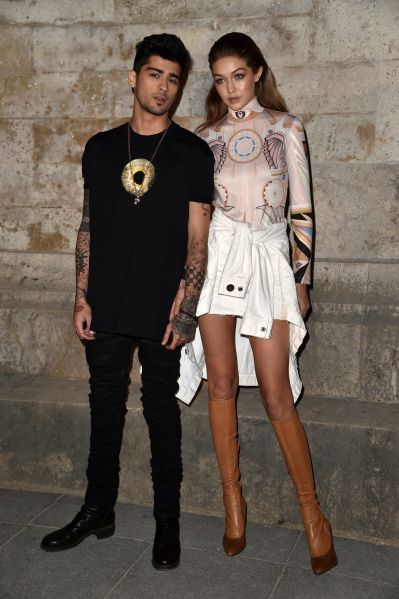 Zayn Malik with Gigi Hadid at the Givenchy show.