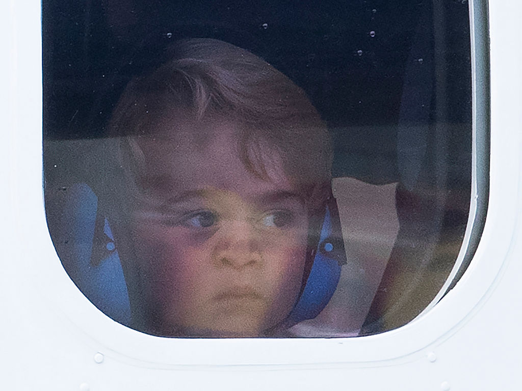 VICTORIA, BC - OCTOBER 01: Prince George of Cambridge presses his face against the window as he leaves from Victoria Harbour aboard a sea-plane on the final day of their Royal Tour of Canada on October 1, 2016 in Victoria, Canada. The Royal couple along with their Children Prince George of Cambridge and Princess Charlotte are visiting Canada as part of an eight day visit to the country taking in areas such as Bella Bella, Whitehorse and Kelowna