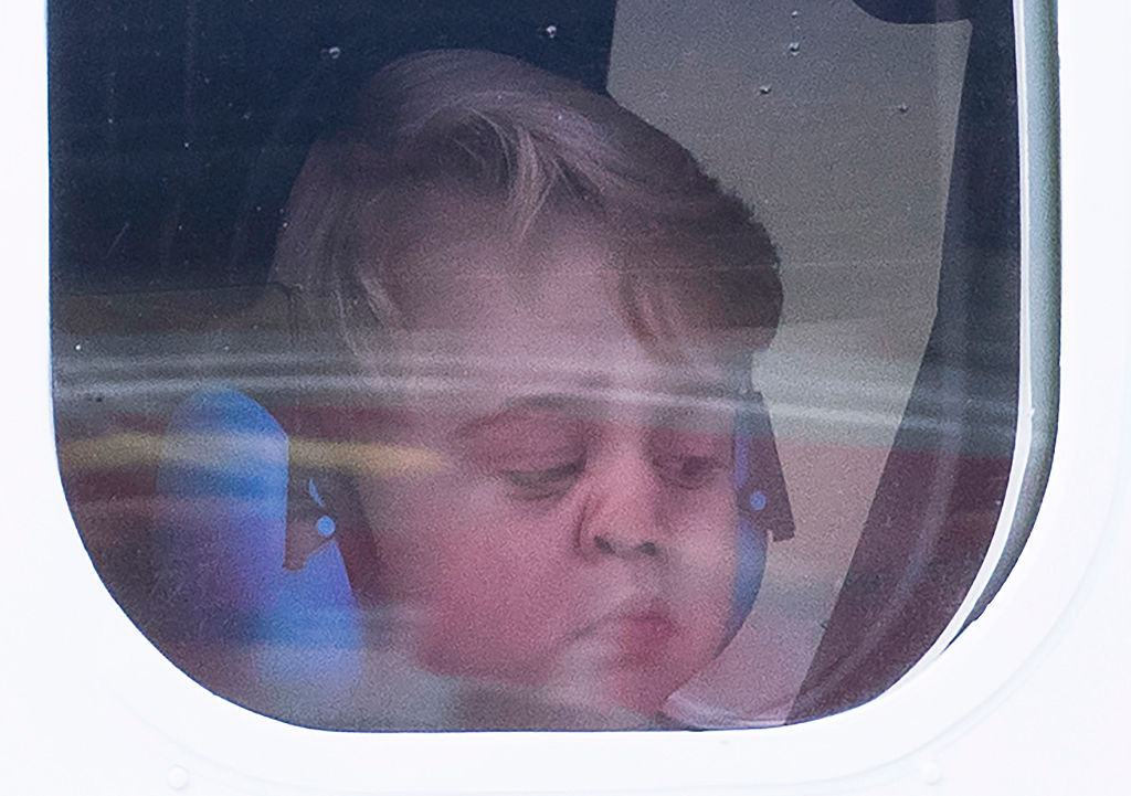 VICTORIA, BC - OCTOBER 01: Prince George of Cambridge presses his face against the window as he leaves from Victoria Harbour aboard a sea-plane on the final day of their Royal Tour of Canada on October 1, 2016 in Victoria, Canada. The Royal couple along with their Children Prince George of Cambridge and Princess Charlotte are visiting Canada as part of an eight day visit to the country taking in areas such as Bella Bella, Whitehorse and Kelowna (Photo by Stephen Lock - Pool/Getty Images)
