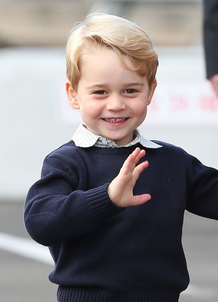 Prince George waves goodbye to his admirers.