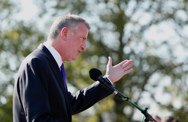 New York Mayor Bill de Blasio speaks as he attends a ceremony to unveil plans and break ground for a new Statue of Liberty Museum on Liberty Island in New York on October 6, 2016.