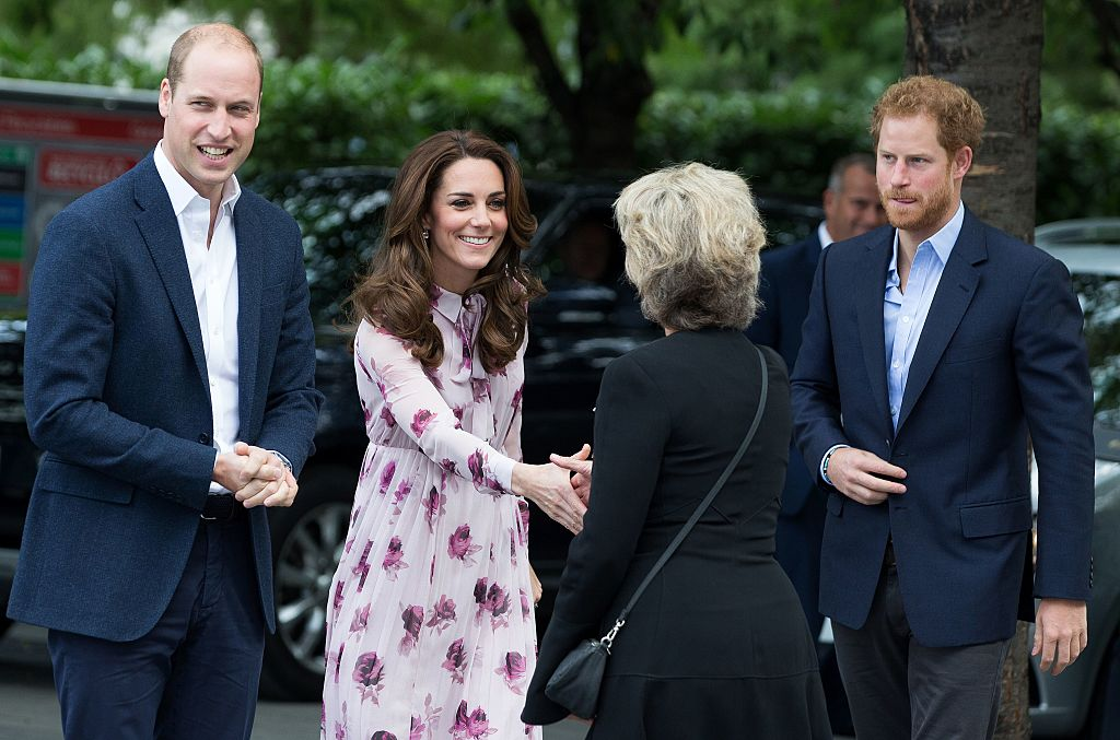 Prince William, Catherine, Duchess of Cambridge (2L) and Britain's Prince Harry (R) are greeted as they arrive for a visit to County Hall and The London Eye in central London on October 10, 2016. The Duke and Duchess of Cambridge, along with Prince Harry, were due to speak at an event recognising World Mental Health day.