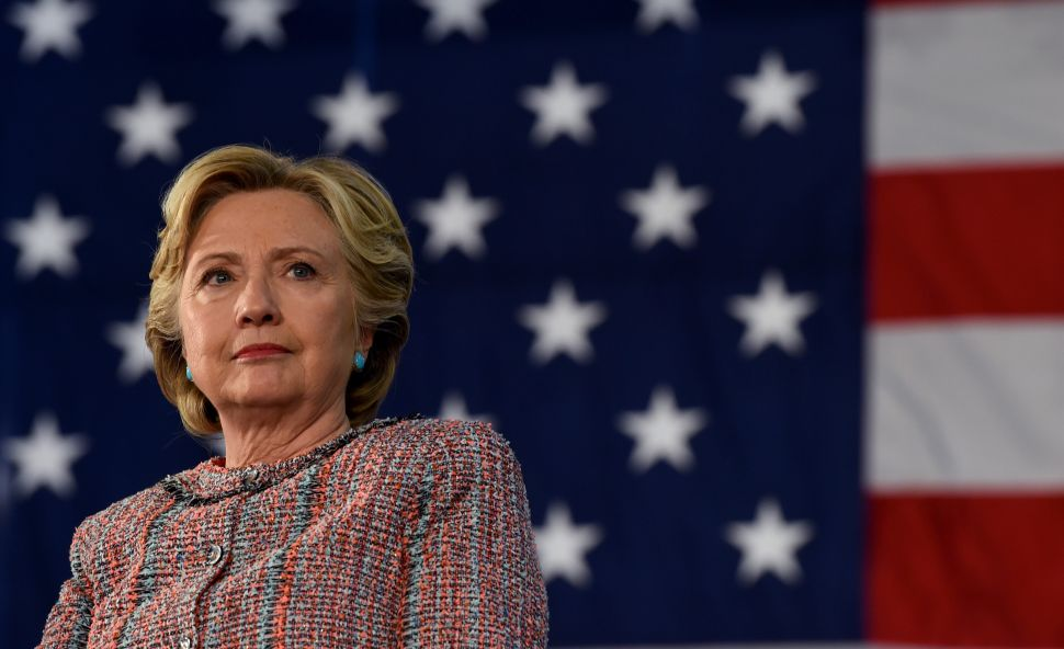 Democrat Presidential nominee Hillary Clinton looks on during an event on climate change at Miami Dade College-Kendall Campus in Miami, Florida October 11, 2016.