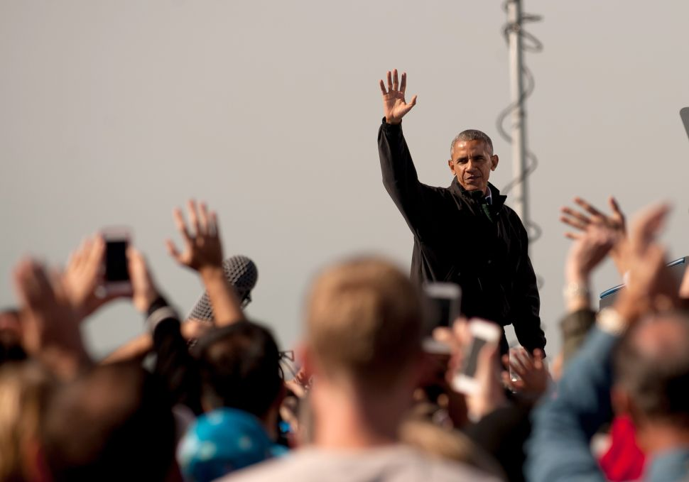 """President Barack Obama campaigns for Hillary Clinton at a """"Get Out the Early Vote"""" rally at Cleveland Burke Lakefront Airport in Cleveland, Ohio on October 14, 2016. Early voting began on October 12 in Ohio."""
