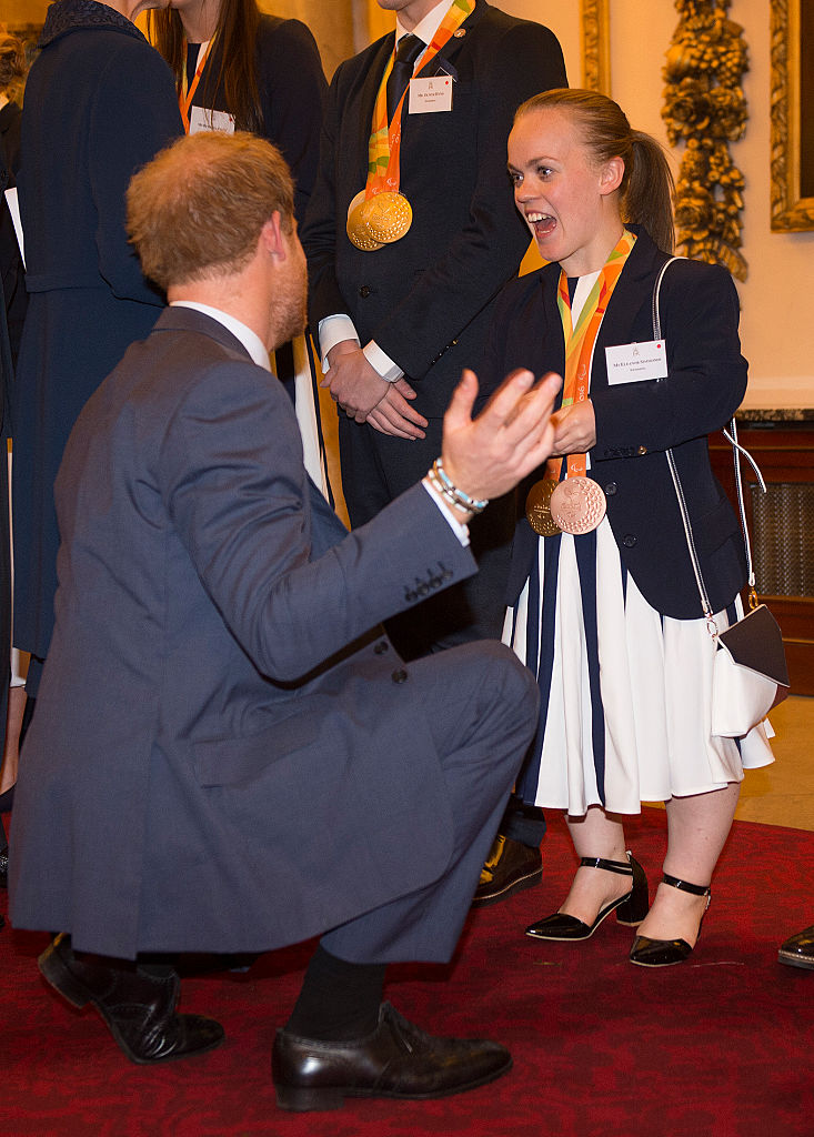 Prince Harry speaks with paralympian Ellie Simmonds at a reception for Team GB's 2016 Olympic and Paralympic teams at Buckingham Palace October 18, 2016 in London, England. (Photo by Eddie Mulholland - WPA Pool /Getty Images)