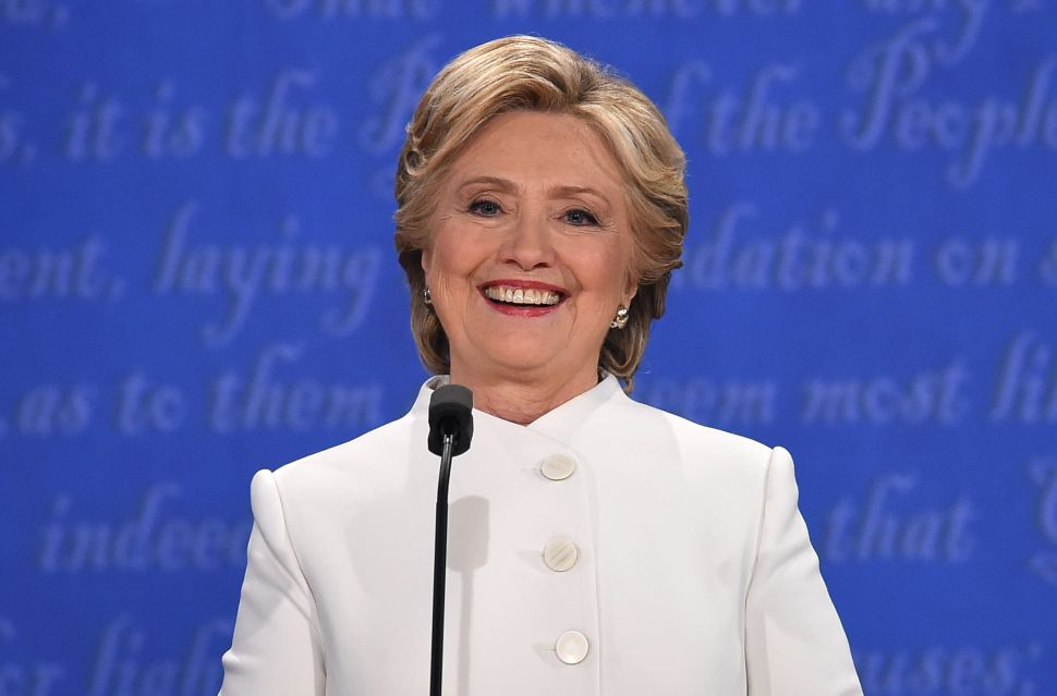Democratic nominee Hillary Clinton smiles during the final presidential debate at the Thomas & Mack Center on the campus of the University of Las Vegas in Las Vegas, Nevada on October 19, 2016. / AFP / Robyn Beck