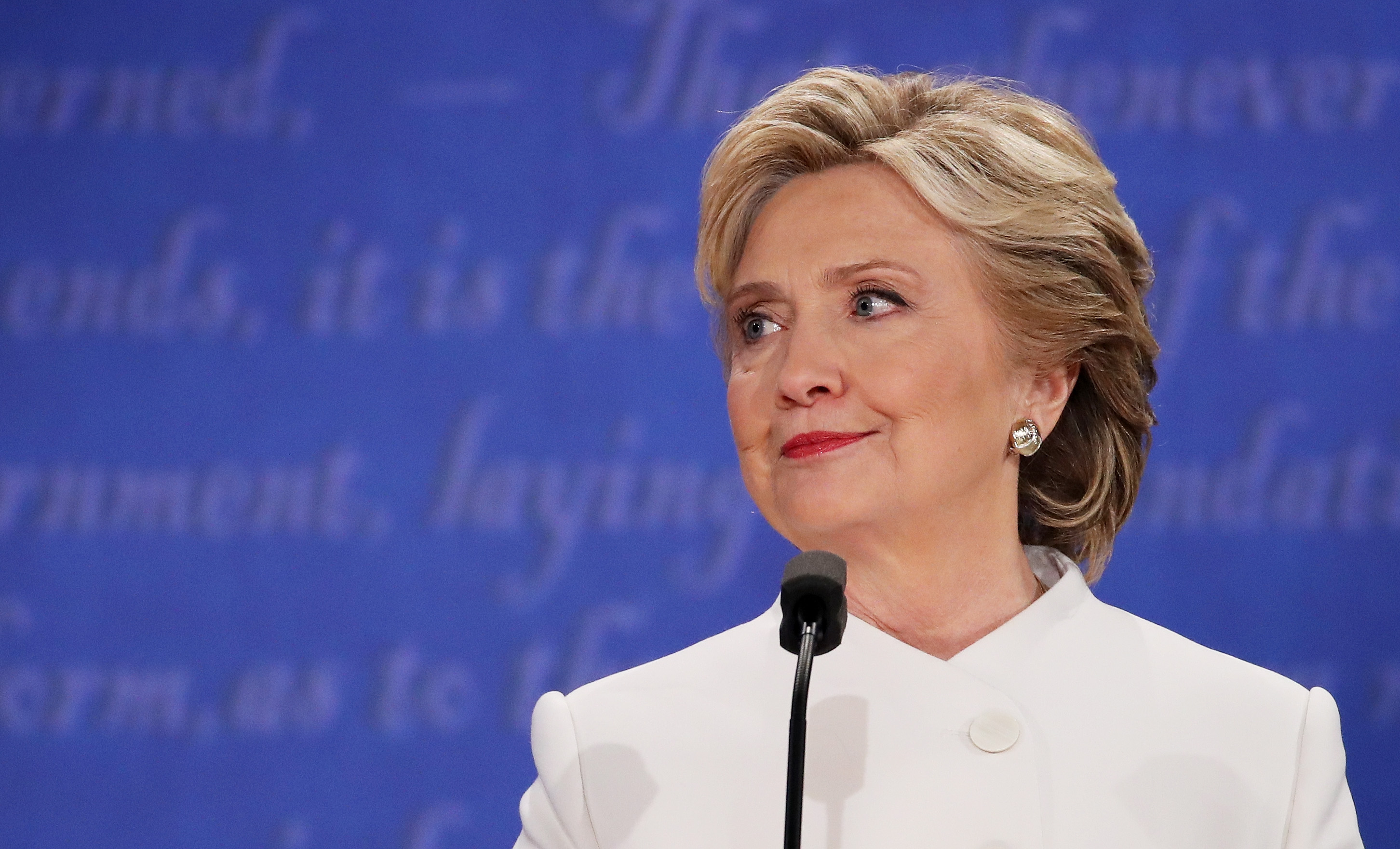 Hillary Clinton listens to Republican presidential nominee Donald Trump speak during the third U.S. presidential debate at the Thomas & Mack Center on October 19, 2016 in Las Vegas, Nevada.