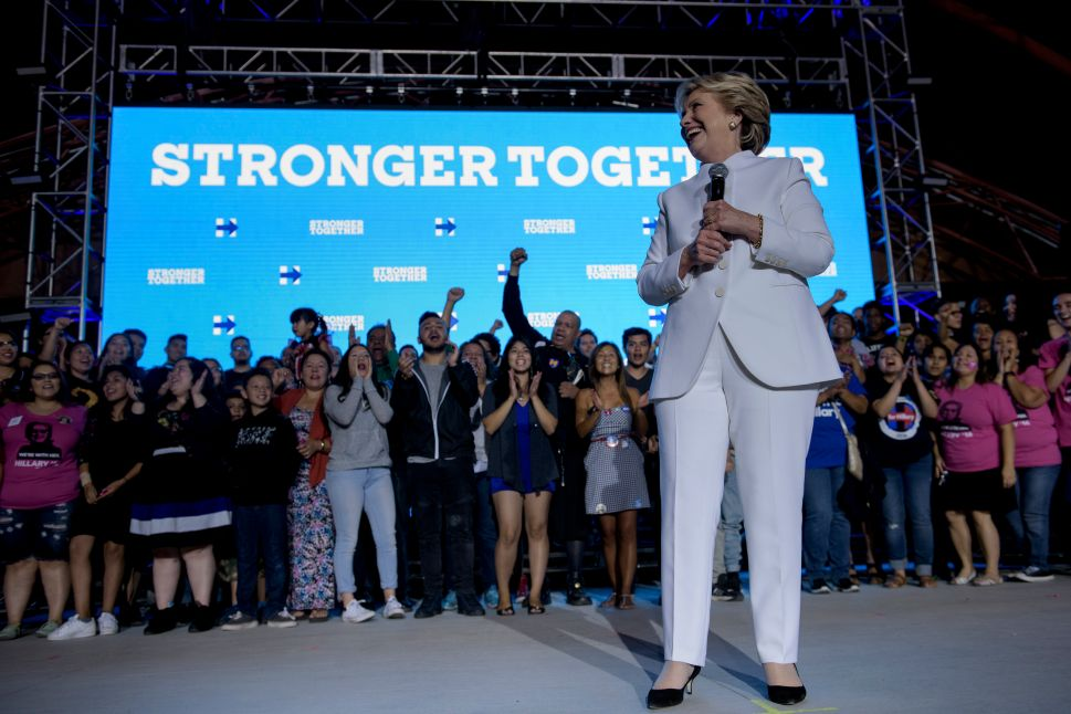 Democratic presidential nominee Hillary Clinton pauses while speaking to supporters at Craig Ranch Regional Park Amphitheater after the final presidential debate at the University of Nevada October 19, 2016 in North Las Vegas, Nevada / AFP /
