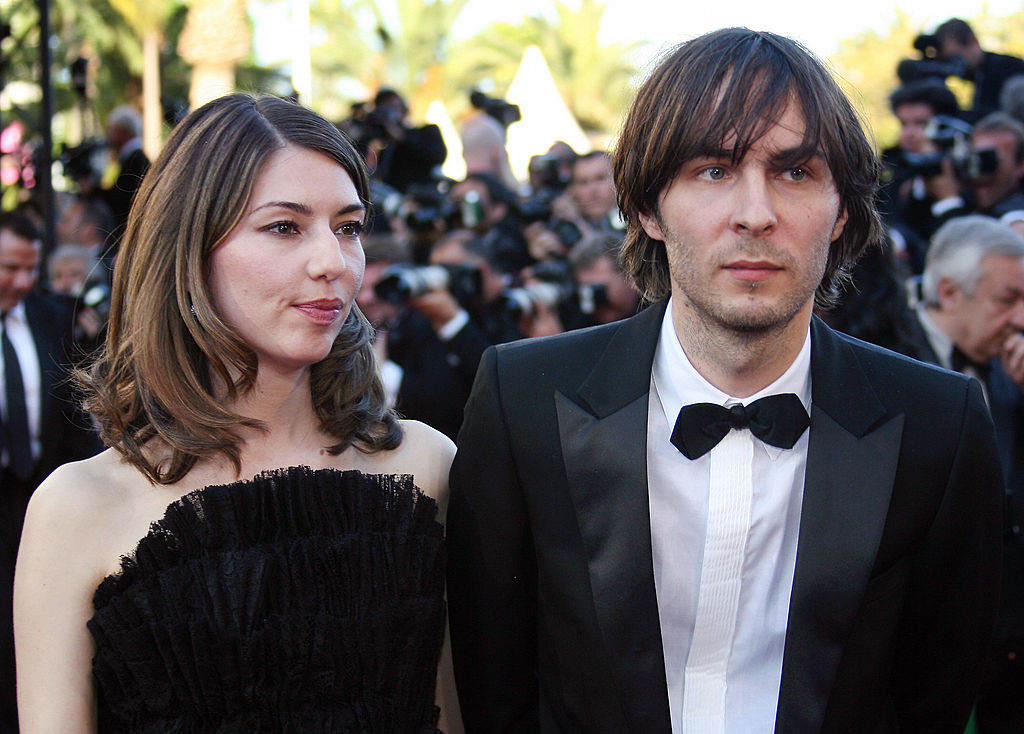 Cannes, FRANCE: (FILES) This file picture taken 24 May 2006 prior the premiere of 'Marie Antoinette' at Cannes festival shows US director Sofia Coppola arriving at the Festival Palace with her companion Phoenix singer Thomas Mars. US People magazine reported 01 June 2006 on its website that Sofia Coppola is pregnant and the child's father is her boyfriend, French rock singer Thomas Mars. AFP PHOTO/FILES/ PASCAL GUYOT (Photo credit should read PASCAL GUYOT/AFP/Getty Images)