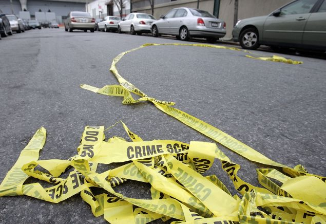 Police crime scene tape lies in the street outside Club Kalua club where Sean Bell was shot and killed November 28, 2006 in Jamaica, Queens, New York City.