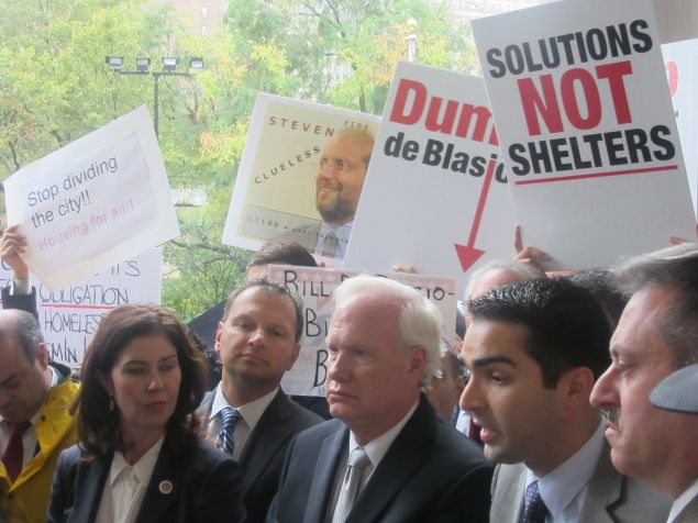 Elected officials from Queens protested at City Hall over what they believe is Mayor Bill de Blasio's failed policy for addressing the city's homelessness crisis.