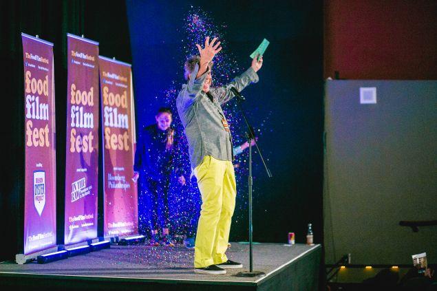 Festival director George Motz revels in confetti on opening night.