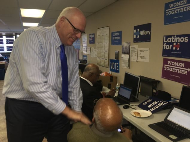 Congressman Joseph Crowley talks with a phone banker.