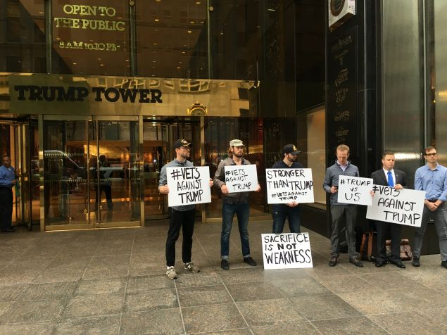 A group of local U.S. military veterans rally in front of Trump Tower.