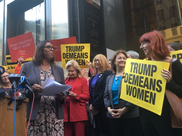 Public Advocate Letitia James protests in front of Trump Tower with other female elected officials and advocates.