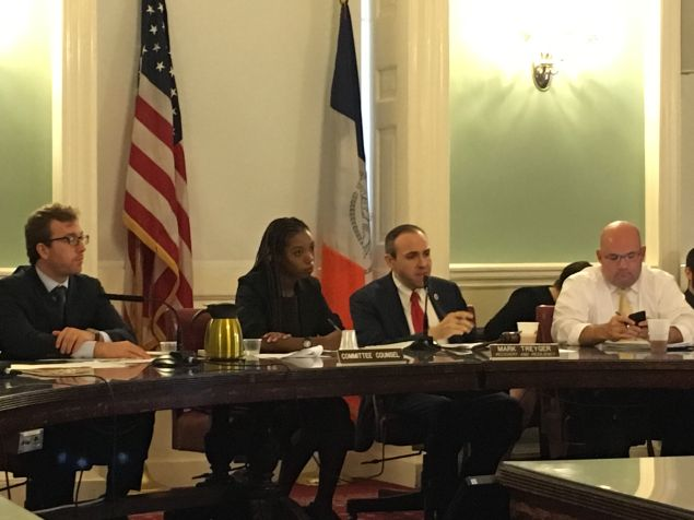 Councilman Mark Treyger, center, and Councilman Steven Matteo, right, listen to testimony from Mayor de Blasio's administration about the Build It Back program.