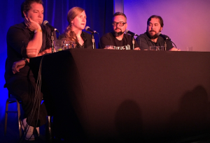Criminals Phoebe Judge, speaking, at the LA Podfest. On stage with Jay Larson, Hal Lublin and Jeffrey Cranor.