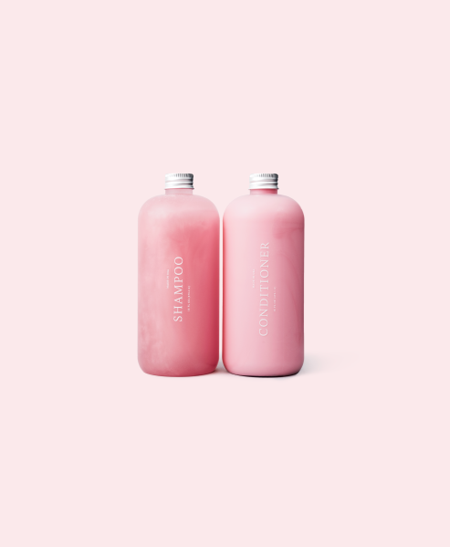 Shampoo and conditioner in pink.