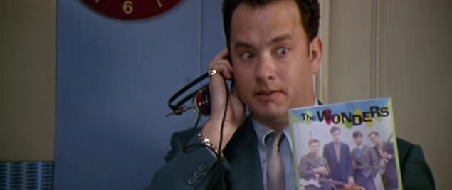 Tom Hanks using a prehistoric iPhone to listen a floppy disk (I presume).