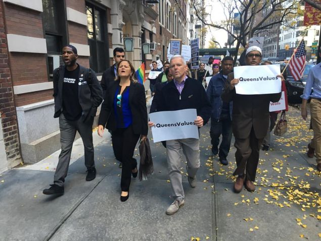 Councilman Jimmy Van Bramer, center, leads Queens protesters in Manhattan, flanked by Councilman Jumaane Williams and Council Speaker Melissa Mark-Viverito.