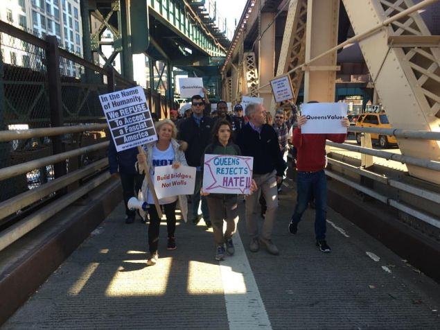 Queens Councilman Jimmy Van Bramer and protesters make their way onto the Queensboro Bridge.