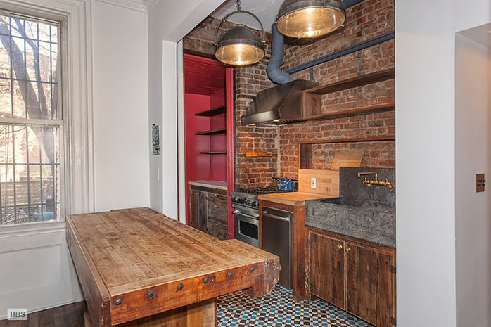 Kitchen with butcher-block counters.