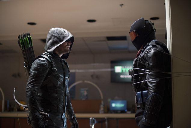 Stephen Amell as The Green Arrow and Vigilante.