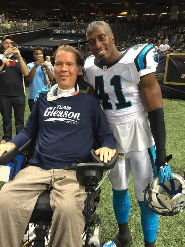 Former New Orleans Saints safety Steve Gleason, who has ALS, with Saints strong safety Roman Harper.