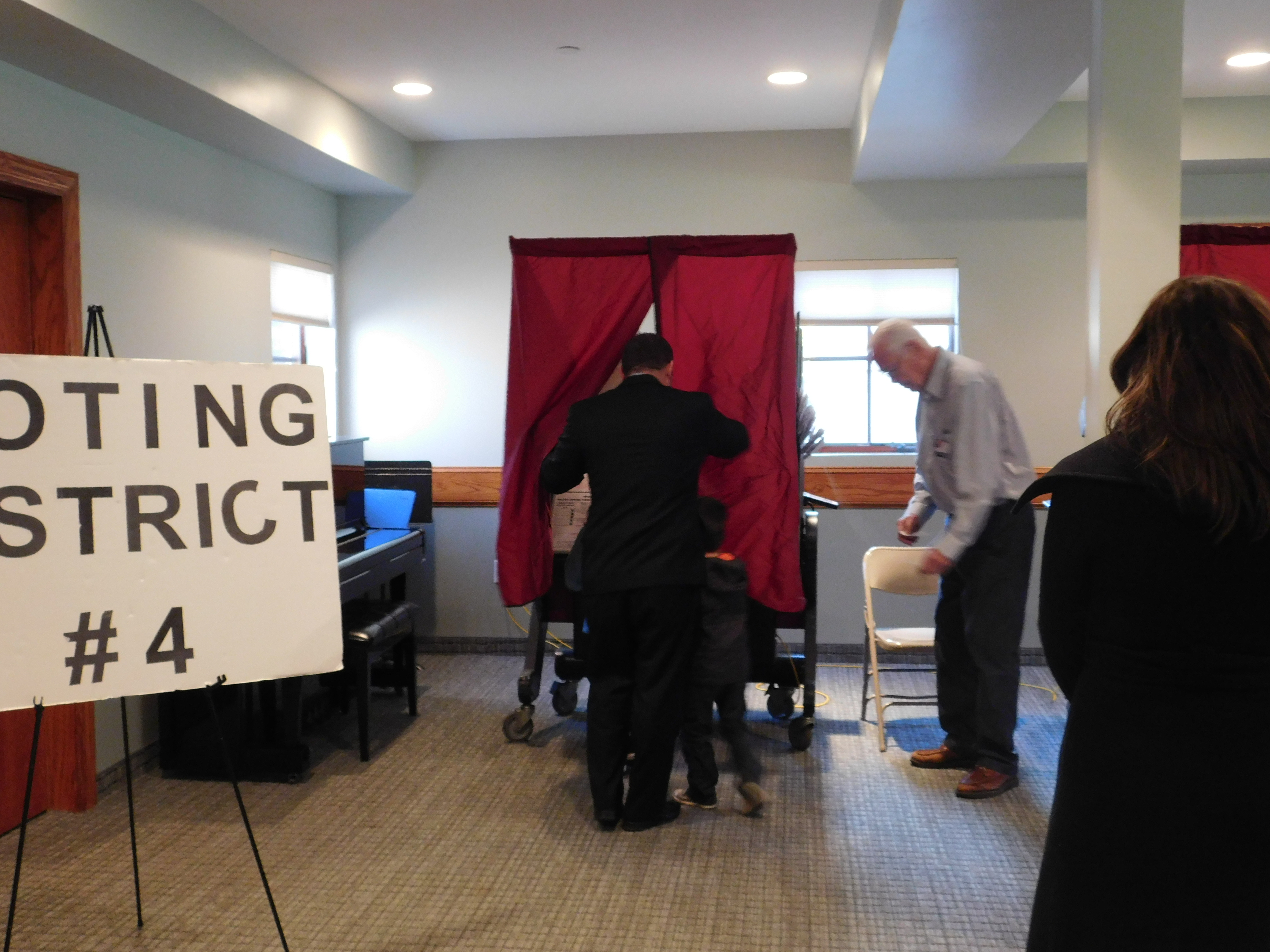 Gottheimer enters the voting booth with his children Ben and Ellie.