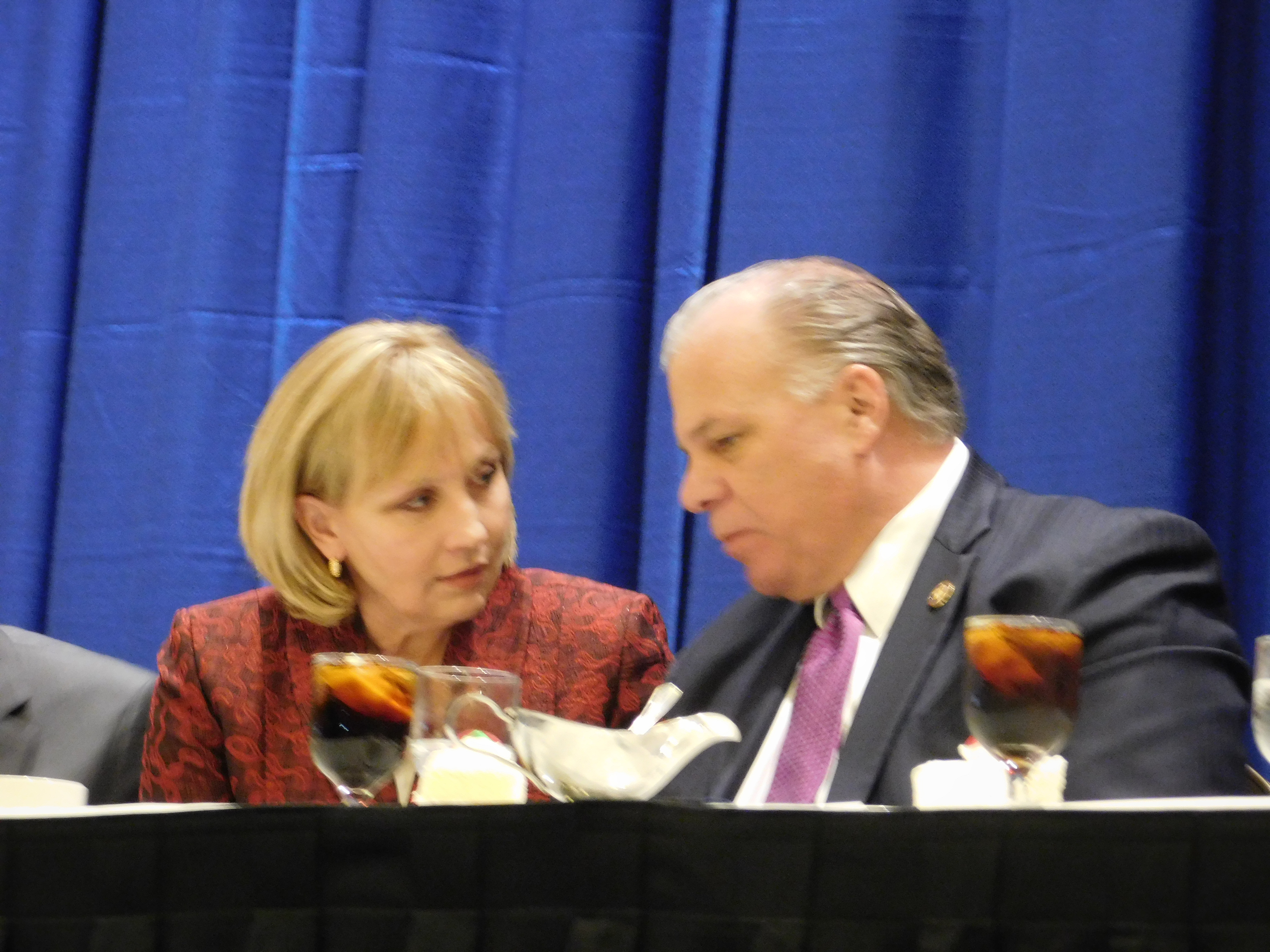 Guadagno and Senate President Steve Sweeney sit at the head table during Christie's speech.