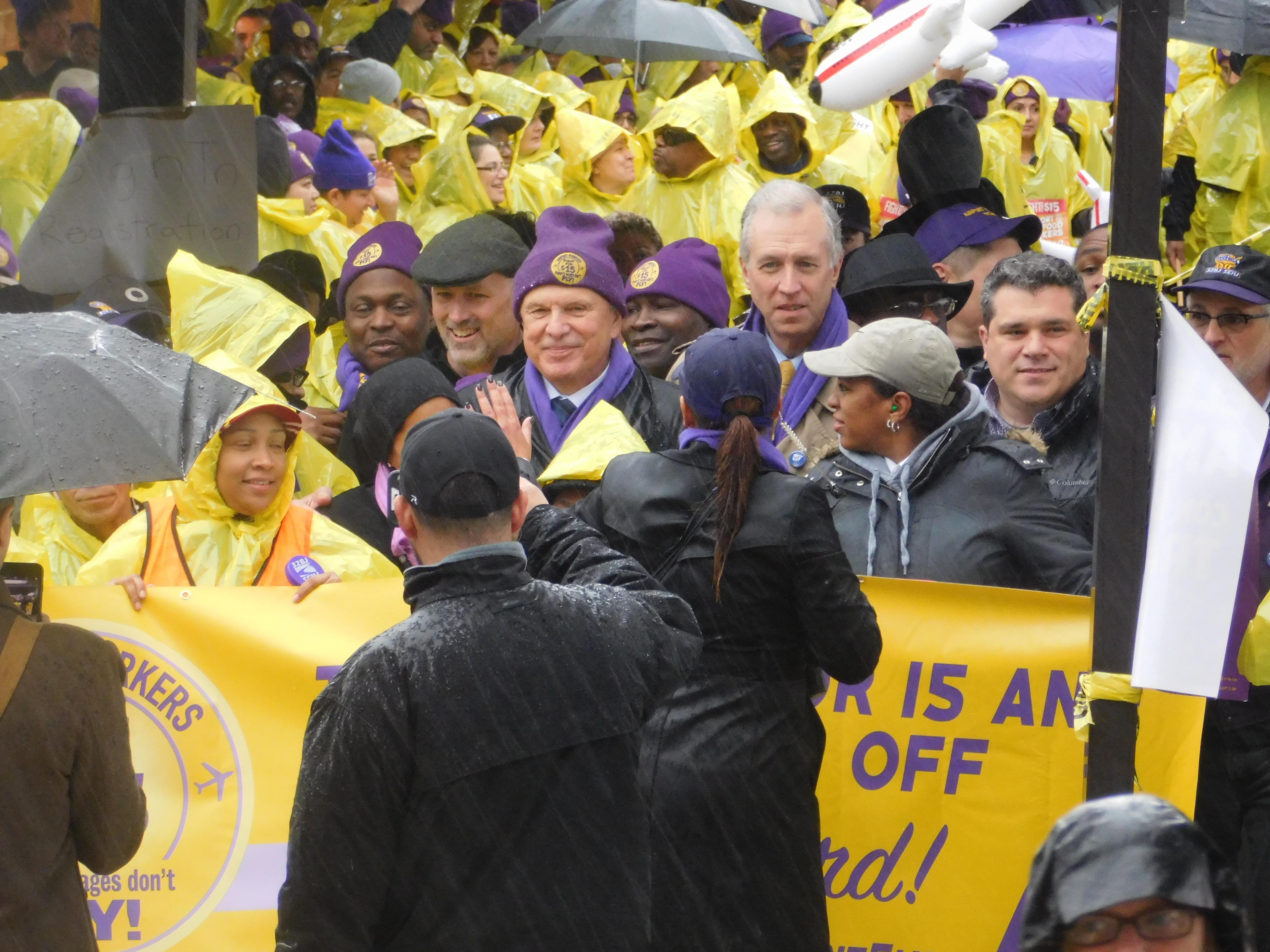 State Senator Ray Lesniak and Assemblyman John Wisniewski can be seen among those gathered outside of Newark Airport's terminal B.